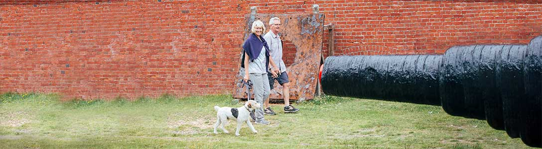 Dog walker at Hurst Castle